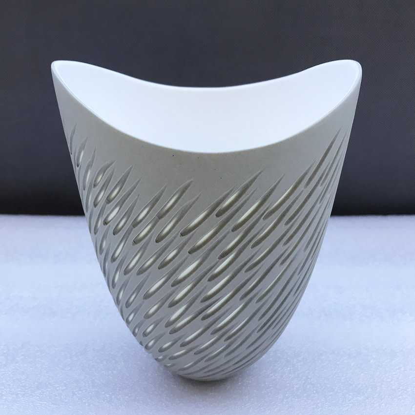"""<span class=""""link fancybox-details-link""""><a href=""""/artists/60-sasha-wardell/works/7493-sasha-wardell-shoal-vase-2021/"""">View Detail Page</a></span><div class=""""artist""""><strong>Sasha Wardell</strong></div> b. 1956 <div class=""""title""""><em>'Shoal' Vase</em>, 2021</div> <div class=""""signed_and_dated"""">inscribed with the artist's initials to the base</div> <div class=""""medium"""">sepia/white layered and sliced bone china</div> <div class=""""dimensions"""">h. 13 cm x w. (widest point) 17 cm</div><div class=""""price"""">£190.00</div><div class=""""copyright_line"""">Own Art: £19 x 10 months, 0% APR</div>"""