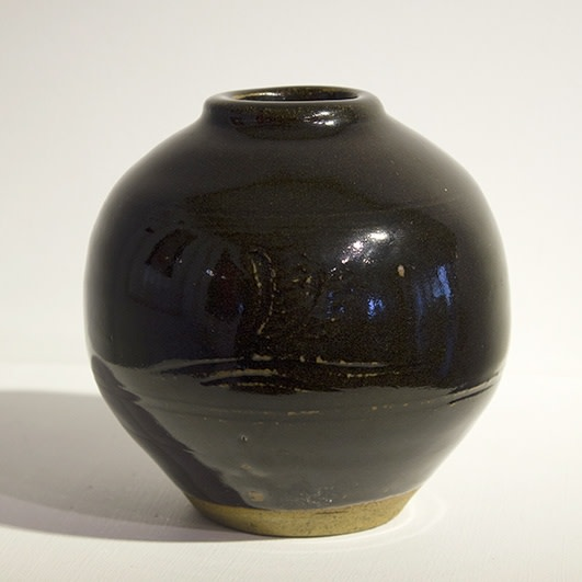 "<span class=""link fancybox-details-link""><a href=""/artists/131-bernard-leach-ch-cbe/works/3020-bernard-leach-ch-cbe-vase-c.-1958/"">View Detail Page</a></span><div class=""artist""><strong>Bernard Leach CH CBE</strong></div> 1887–1979 <div class=""title""><em>Vase</em>, c. 1958</div> <div class=""signed_and_dated"">Impressed 'BL' seal-mark alongside the Leach Pottery and 'ENGLAND' marks</div> <div class=""medium"">Reduced stoneware with tenmoku glaze, incised motifs within two bands of incised lines</div> <div class=""dimensions"">H 14 cm<br />5 1/2 inches<br />Dia. 14 cm<br />5 1/2 inches</div><div class=""copyright_line"">The estate of Bernard Leach</div>"