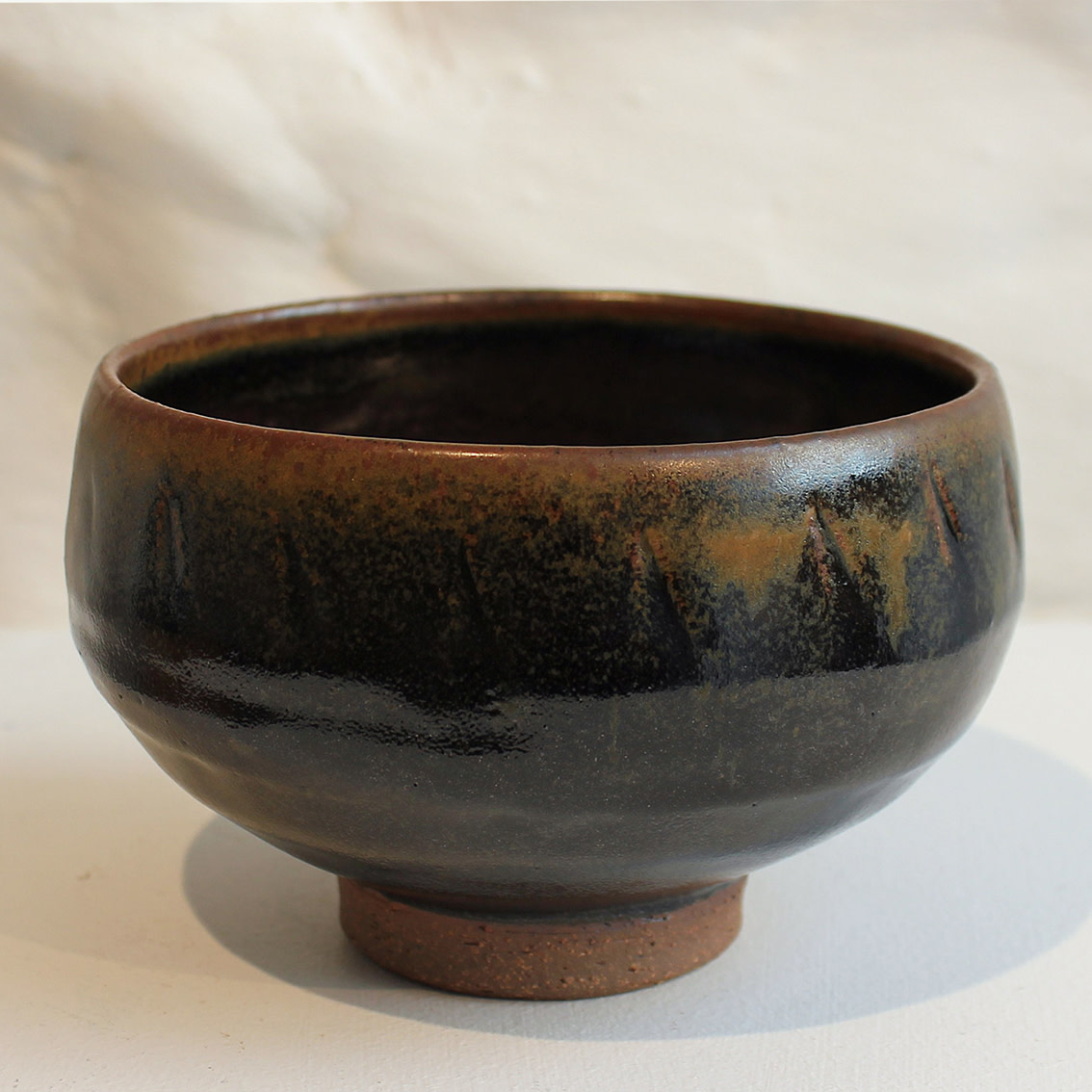 "<span class=""link fancybox-details-link""><a href=""/artists/200-matthew-tyas/works/5453-matthew-tyas-tenmoku-ash-chawan-bowl-2018/"">View Detail Page</a></span><div class=""artist""><strong>Matthew Tyas</strong></div> <div class=""title""><em>Tenmoku Ash Chawan Bowl</em>, 2018</div> <div class=""signed_and_dated"">stamped by the artist</div> <div class=""medium"">glazed thrown stoneware</div><div class=""price"">£75.00</div><div class=""copyright_line"">Copyright The Artist</div>"