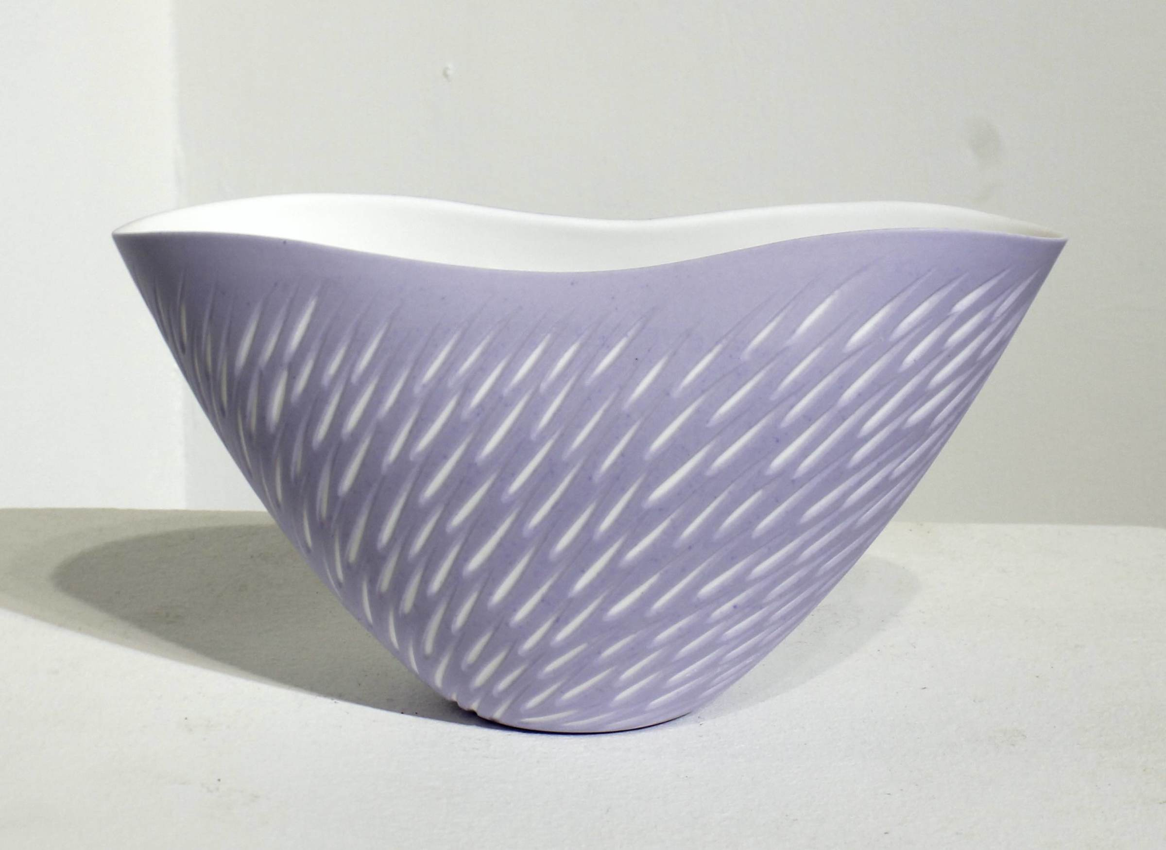 "<span class=""link fancybox-details-link""><a href=""/artists/60-sasha-wardell/works/5118-sasha-wardell-lavender-shoal-vase-2017/"">View Detail Page</a></span><div class=""artist""><strong>Sasha Wardell</strong></div> <div class=""title""><em>Lavender Shoal Vase </em>, 2017</div> <div class=""signed_and_dated"">inscribed with artist initials on base</div> <div class=""medium"">layered and sliced bone china</div> <div class=""dimensions"">h. 11 x w. 19 x d. 8.5 cm</div>"