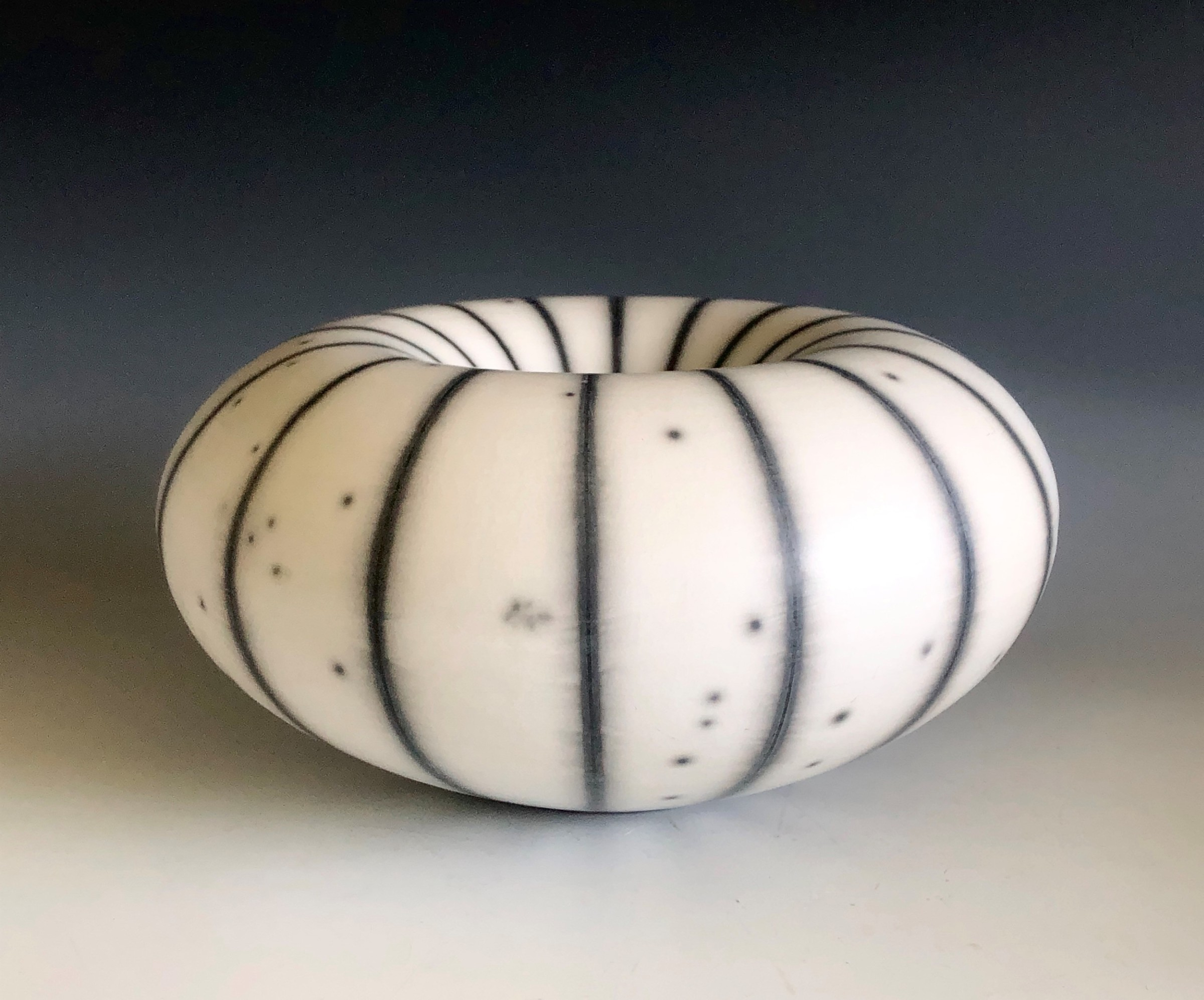 "<span class=""link fancybox-details-link""><a href=""/artists/98-tim-andrews/works/7278-tim-andrews-resist-striped-humbug-form/"">View Detail Page</a></span><div class=""artist""><strong>Tim Andrews</strong></div> b. 1960 <div class=""title""><em>Resist Striped 'Humbug' form</em></div> <div class=""signed_and_dated"">impressed monogram 'TA' and '30' anniversary marks</div> <div class=""medium"">raku-fired porcelain body and 'T' material with resist slip and glaze, burnished</div> <div class=""dimensions"">h 11 cm x d 23 cm</div><div class=""price"">£800.00</div><div class=""copyright_line"">Copyright The Artist</div>"