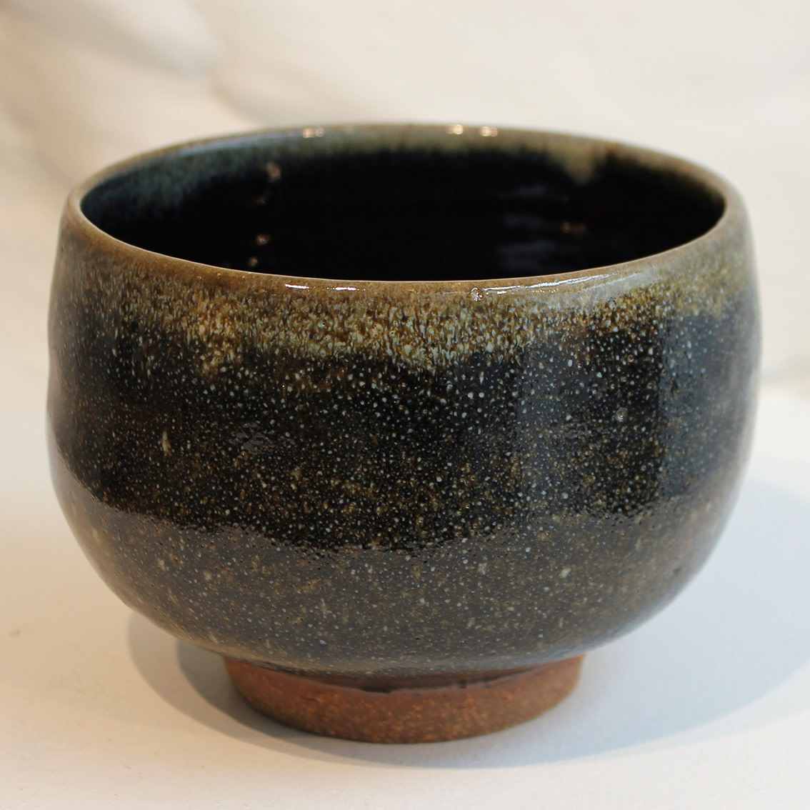 "<span class=""link fancybox-details-link""><a href=""/artists/200-matthew-tyas/works/5452-matthew-tyas-starling-chawan-bowl-2018/"">View Detail Page</a></span><div class=""artist""><strong>Matthew Tyas</strong></div> <div class=""title""><em>Starling Chawan Bowl</em>, 2018</div> <div class=""signed_and_dated"">stamped by the artist</div> <div class=""medium"">glazed thrown stoneware</div><div class=""copyright_line"">Copyright The Artist</div>"