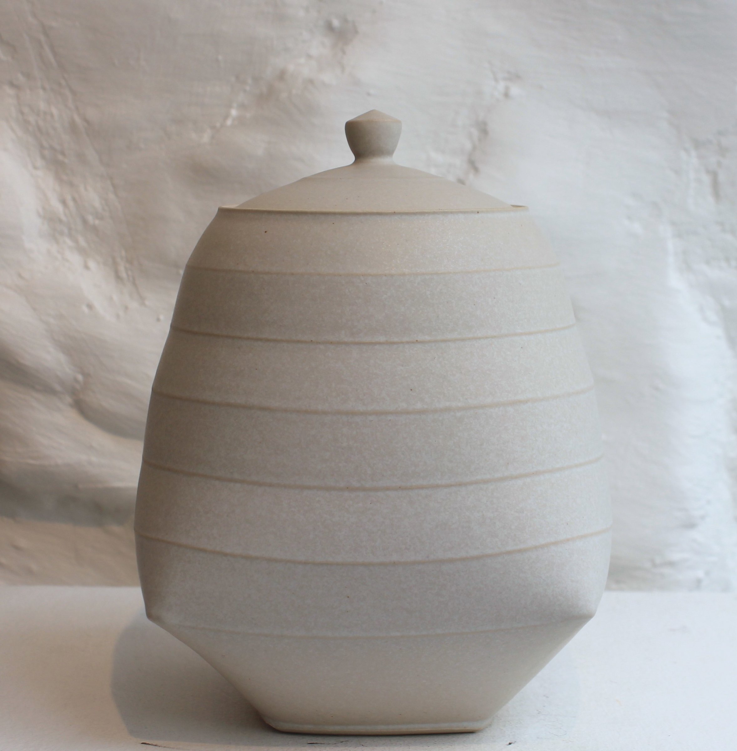 "<span class=""link fancybox-details-link""><a href=""/artists/33-sun-kim/works/5744-sun-kim-medium-lidded-jar-2018/"">View Detail Page</a></span><div class=""artist""><strong>Sun Kim</strong></div> <div class=""title""><em>Medium Lidded Jar</em>, 2018</div> <div class=""signed_and_dated"">stamped by the artist</div> <div class=""medium"">porcelain</div> <div class=""dimensions"">19 x 12 x 9.5 cm<br /> 7 1/2 x 4 3/4 x 3 3/4 inches</div><div class=""copyright_line"">OwnArt: £ 32 x 10 Months, 0% APR</div>"
