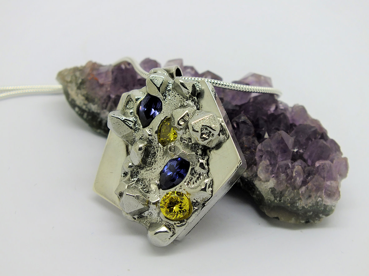 <span class=&#34;link fancybox-details-link&#34;><a href=&#34;/artists/154-stacey-west/works/3946-stacey-west-found-treasures-pendant-large-2017/&#34;>View Detail Page</a></span><div class=&#34;artist&#34;><strong>Stacey West</strong></div> <div class=&#34;title&#34;><em>'Found Treasures' Pendant – large</em>, 2017</div> <div class=&#34;medium&#34;>Pewter and silver with purple and yellow cubic zirconia on sterling silver chain</div><div class=&#34;copyright_line&#34;>Copyright The Artist</div>
