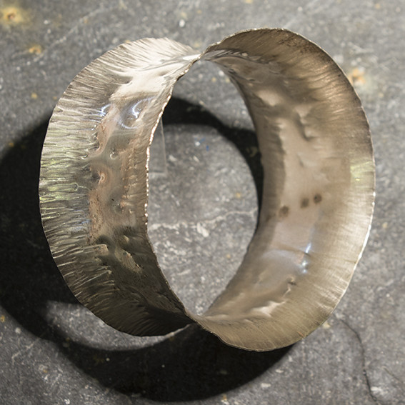 "<span class=""link fancybox-details-link""><a href=""/artists/148-roberta-hopkins/works/3570-roberta-hopkins-silver-ribbon-bangle-extra-wide-2015/"">View Detail Page</a></span><div class=""artist""><strong>Roberta Hopkins</strong></div> <div class=""title""><em>Silver 'Ribbon' bangle - extra wide</em>, 2015</div> <div class=""medium"">sterling silver</div><div class=""copyright_line"">Own Art: £18 x 10 Monthly 0% APR Representative Payments</div>"