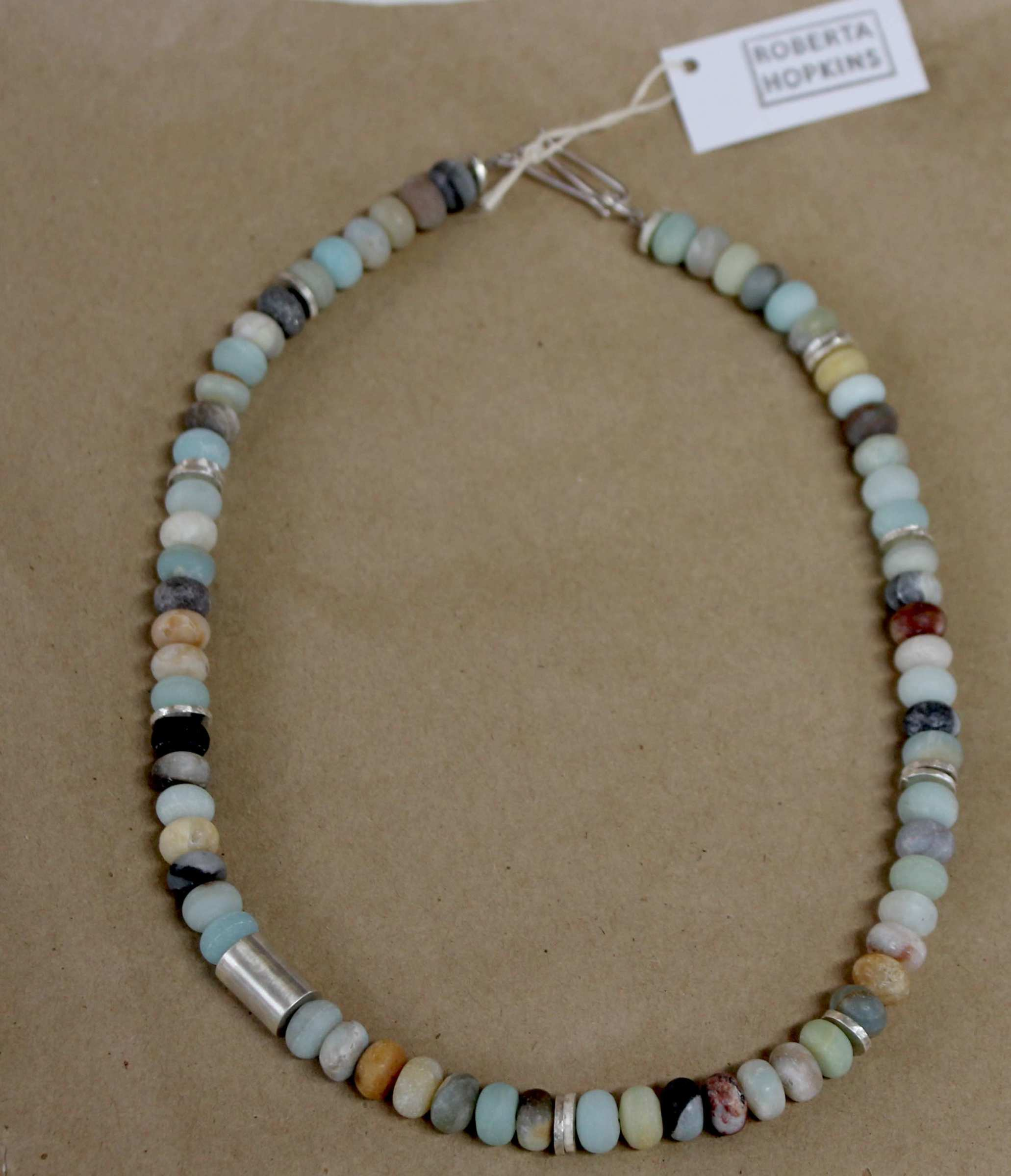 "<span class=""link fancybox-details-link""><a href=""/artists/148-roberta-hopkins/works/5842-roberta-hopkins-black-amazonite-small-rondelles-2018/"">View Detail Page</a></span><div class=""artist""><strong>Roberta Hopkins</strong></div> <div class=""title""><em>Black Amazonite Small Rondelles</em>, 2018</div> <div class=""medium"">sterling silver</div><div class=""price"">£135.00</div><div class=""copyright_line"">£ 13.50 x 10 Months, OwnArt 0% APR</div>"