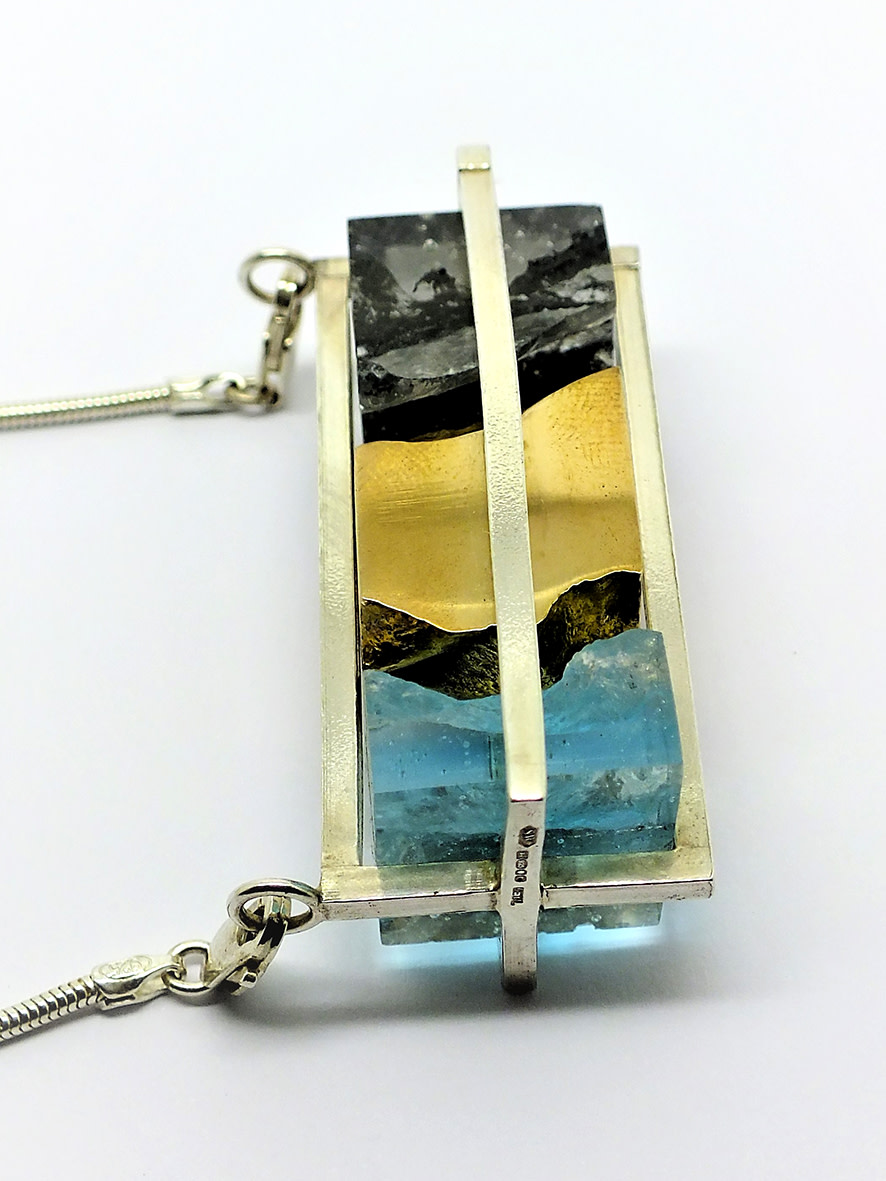 <span class=&#34;link fancybox-details-link&#34;><a href=&#34;/artists/154-stacey-west/works/3929-stacey-west-interlocking-strata-necklace-porthmeor-2017/&#34;>View Detail Page</a></span><div class=&#34;artist&#34;><strong>Stacey West</strong></div> <div class=&#34;title&#34;><em>'Interlocking Strata' Necklace – 'Porthmeor'</em>, 2017</div> <div class=&#34;medium&#34;>Sterling silver cage with white bronze  and glass moving interlocking elements on sterling silver chain<br /> Please note: White bronze contains nickel</div><div class=&#34;copyright_line&#34;>Copyright The Artist</div>