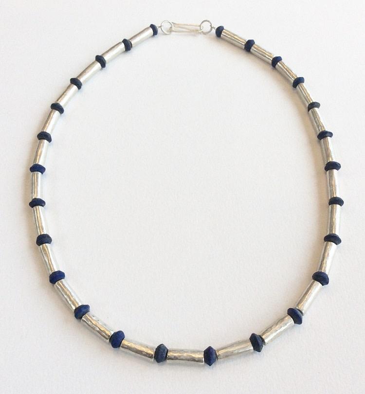 "<span class=""link fancybox-details-link""><a href=""/artists/148-roberta-hopkins/works/6687-roberta-hopkins-lapis-lazuli-and-silver-tubes-medium-2019/"">View Detail Page</a></span><div class=""artist""><strong>Roberta Hopkins</strong></div> <div class=""title""><em>Lapis Lazuli and silver tubes (Medium)</em>, 2019</div> <div class=""price"">£440.00</div><div class=""copyright_line"">Ownart: £22 x 10 Months, 0% APR</div>"