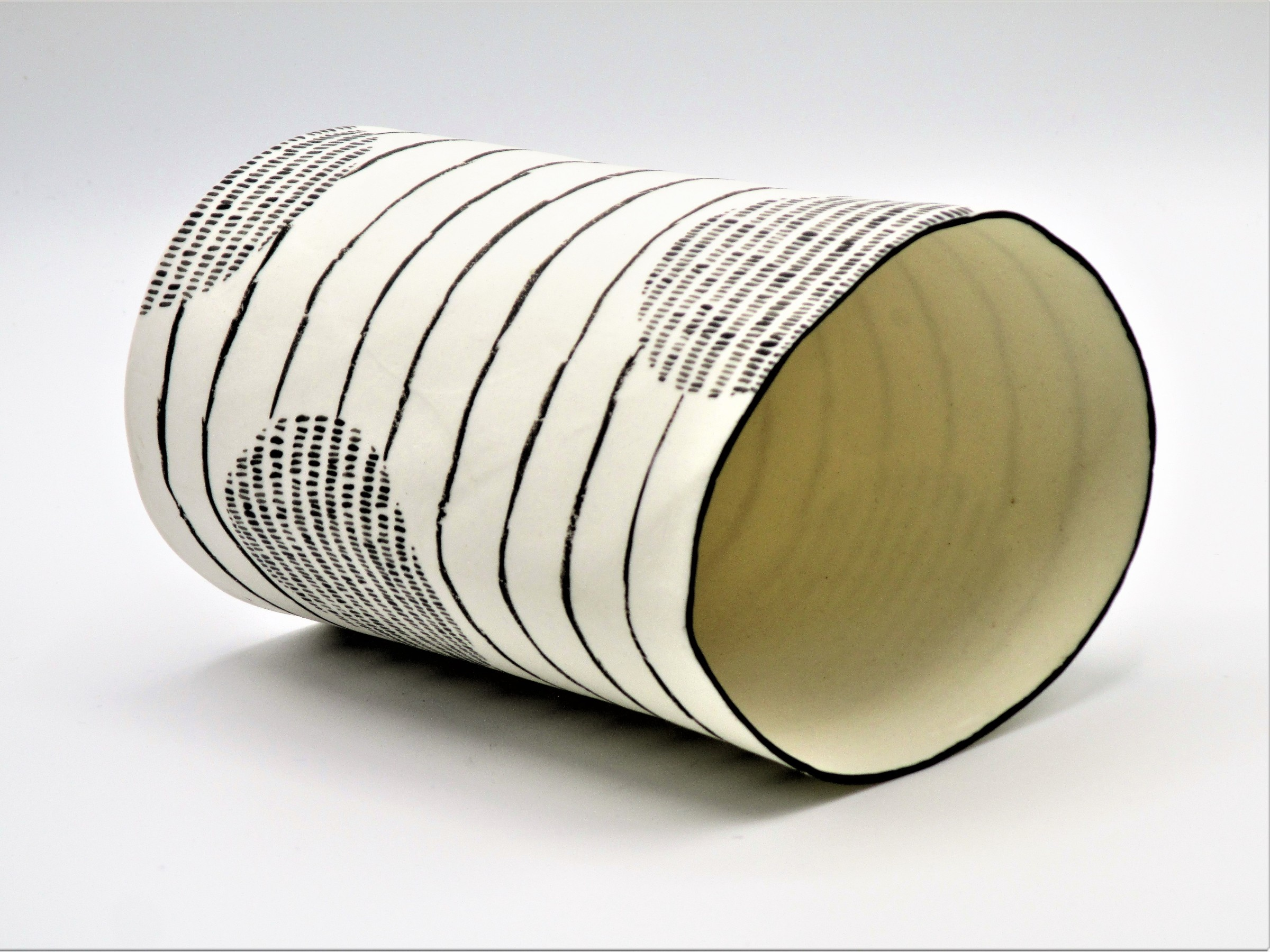 """<span class=""""link fancybox-details-link""""><a href=""""/artists/226-jane-muende/works/7158-jane-muende-translucent-white-cylinder-with-repeated-black-painted-stitch-2020/"""">View Detail Page</a></span><div class=""""artist""""><strong>Jane Muende</strong></div> <div class=""""title""""><em>Translucent white cylinder with repeated black painted 'stitch lines' and horizontal drawn lines</em>, 2020</div> <div class=""""medium"""">Hand built in paper porcelain</div> <div class=""""dimensions"""">13.5 cm x 7.5 cm </div><div class=""""price"""">£200.00</div><div class=""""copyright_line"""">Own Art: £20 x 1o months 0% APR</div>"""