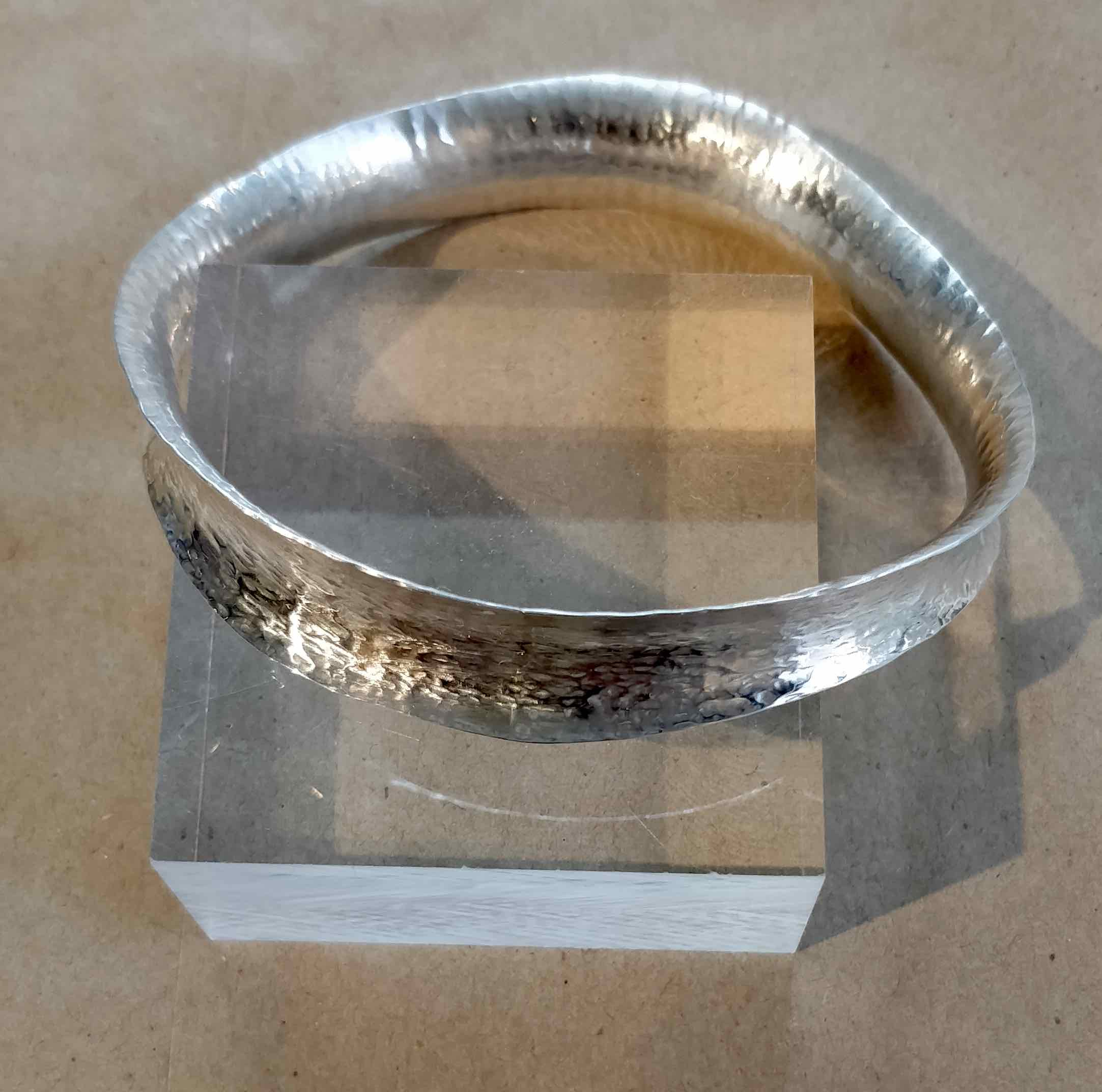 "<span class=""link fancybox-details-link""><a href=""/artists/148-roberta-hopkins/works/5705-roberta-hopkins-wave-bangle-2018/"">View Detail Page</a></span><div class=""artist""><strong>Roberta Hopkins</strong></div> <div class=""title""><em>Wave Bangle</em>, 2018</div> <div class=""medium"">sterling silver</div><div class=""copyright_line"">£ 13.50 x 10 Months, OwnArt 0% APR</div>"