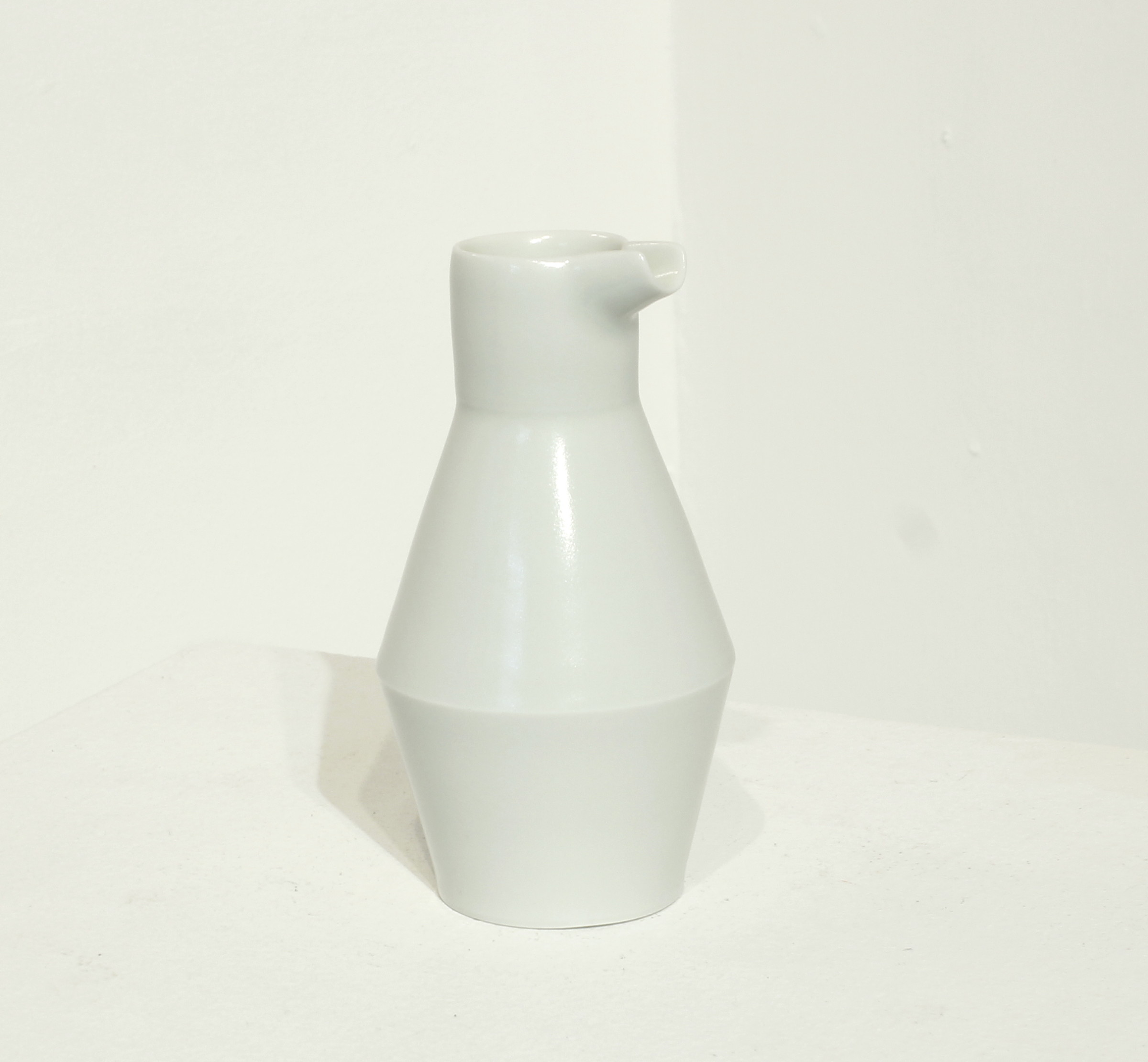 "<span class=""link fancybox-details-link""><a href=""/artists/33-sun-kim/works/5101-sun-kim-milk-jug-2017/"">View Detail Page</a></span><div class=""artist""><strong>Sun Kim</strong></div> <div class=""title""><em>Milk Jug </em>, 2017</div> <div class=""signed_and_dated"">stamped by the artist</div> <div class=""medium"">porcelain</div> <div class=""dimensions"">h. 12 x w. 7 cm </div>"