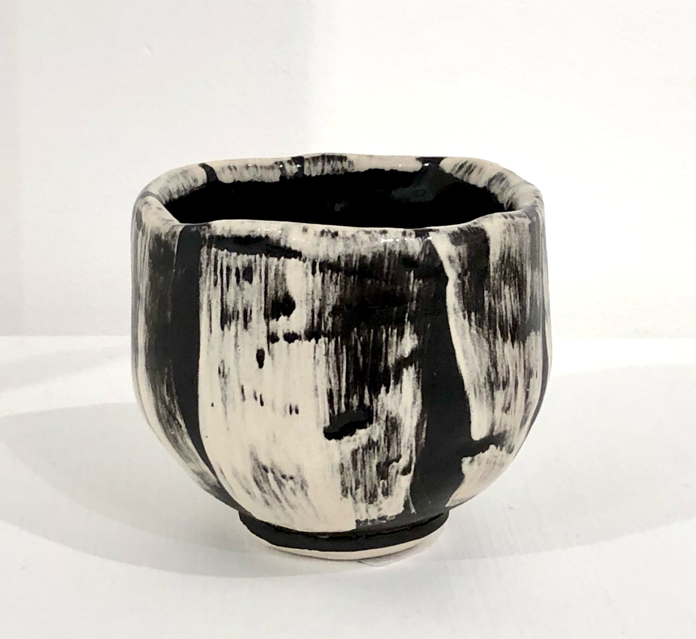 "<span class=""link fancybox-details-link""><a href=""/artists/100-john-pollex/works/7418-john-pollex-tea-bowl-hand-built-2020/"">View Detail Page</a></span><div class=""artist""><strong>John Pollex</strong></div> <div class=""title""><em>Tea bowl (hand built)</em>, 2020</div> <div class=""signed_and_dated"">impressed with the artist's seal mark 'JP'</div> <div class=""medium"">white earthenware decorated with coloured slips</div> <div class=""dimensions"">height. 9 cm x diameter. 9.5 cm</div><div class=""price"">£88.00</div><div class=""copyright_line"">Copyright The Artist</div>"