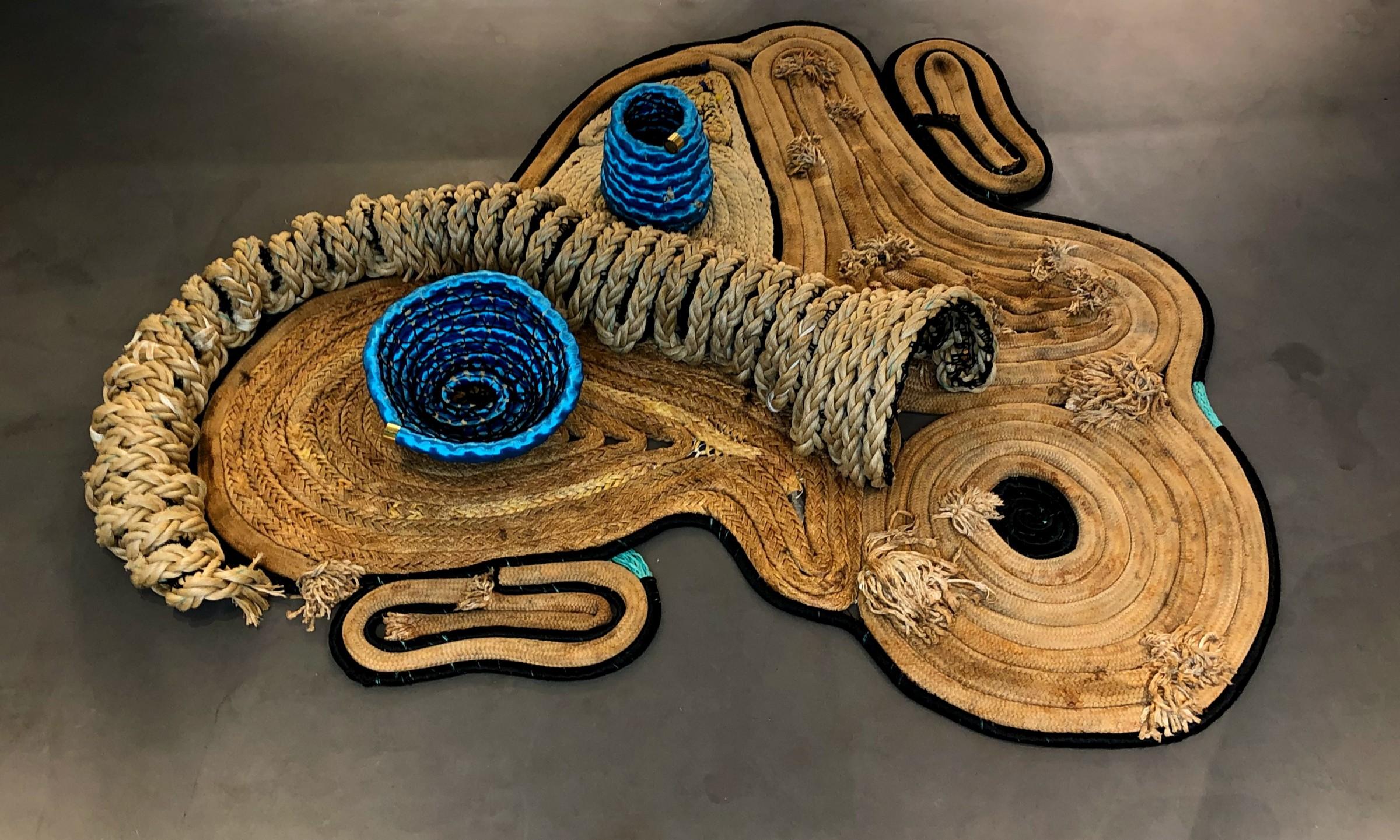 <span class=&#34;link fancybox-details-link&#34;><a href=&#34;/artists/66-joana-schneider/works/5520-joana-schneider-blue-mask-2019/&#34;>View Detail Page</a></span><div class=&#34;artist&#34;><strong>Joana Schneider</strong></div> <div class=&#34;title&#34;><em>Blue Mask</em>, 2019</div> <div class=&#34;medium&#34;>Recycled Ropes</div> <div class=&#34;dimensions&#34;>310 x 290 cm<br /> 122 1/8 x 114 1/8 in</div>