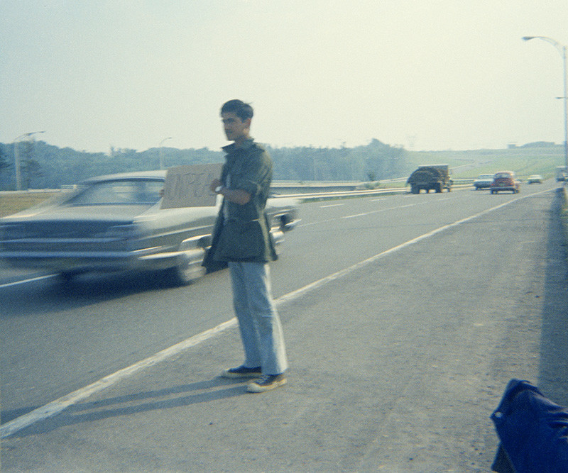 """<span class=""""link fancybox-details-link""""><a href=""""/artists/25-sunil-gupta/works/31964-sunil-gupta-hitch-hiking-back-to-montreal-canadian-forces-base-valcartier-circa-1971/"""">View Detail Page</a></span><div class=""""artist""""><strong>Sunil Gupta</strong></div> b. 1953 <div class=""""title""""><em>Hitch-hiking back to Montreal, Canadian Forces Base Valcartier</em>, circa 1971</div> <div class=""""signed_and_dated"""">Signed, titled, dated, and editioned, in pencil, au verso</div> <div class=""""medium"""">Pigment print on archival paper</div> <div class=""""edition_details"""">Edition of 5</div><div class=""""copyright_line""""> </div>"""
