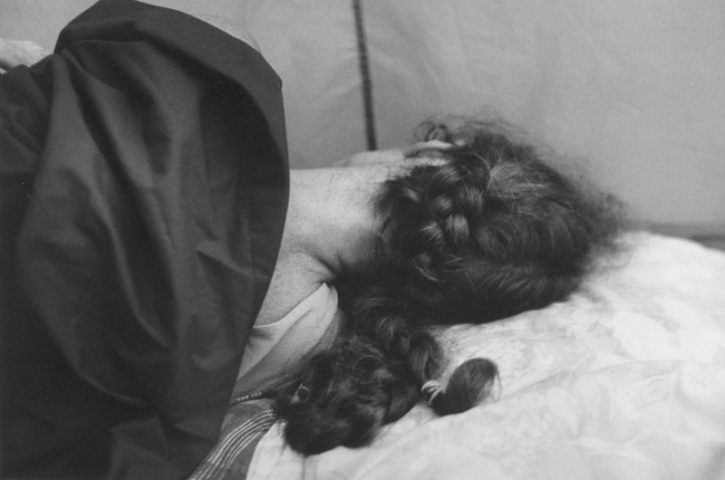 """<span class=""""link fancybox-details-link""""><a href=""""/artists/110-larry-towell/works/11305-larry-towell-ann-sleeping-in-tent-1999/"""">View Detail Page</a></span><div class=""""artist""""><strong>Larry Towell</strong></div> b. 1953 <div class=""""title""""><em>Ann Sleeping in Tent</em>, 1999</div> <div class=""""signed_and_dated"""">Artist's blindstamp, au recto<br /> Signed, titled, and dated, in pencil, au verso<br /> Printed in 2000<br /> </div> <div class=""""medium"""">Gelatin silver print</div> <div class=""""dimensions"""">16 x 20 inch (40.64 x 50.8 cm)</div><div class=""""copyright_line"""">© Larry Towell / Magnum Photos</div>"""