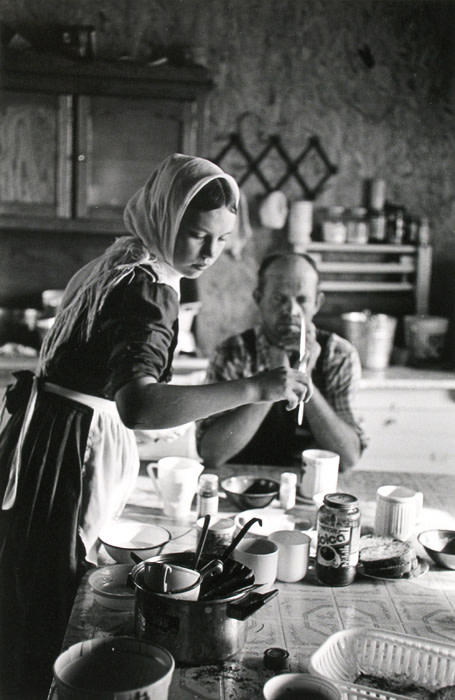 """<span class=""""link fancybox-details-link""""><a href=""""/artists/110-larry-towell/works/13965-larry-towell-temporal-colony-campeche-mexico-young-girl-setting-table-1999/"""">View Detail Page</a></span><div class=""""artist""""><strong>Larry Towell</strong></div> b. 1953 <div class=""""title""""><em>Temporal Colony, Campeche, Mexico [Young girl setting table]</em>, 1999</div> <div class=""""signed_and_dated"""">Signed, titled, and dated, in pencil, au verso<br /> Printed in 2003</div> <div class=""""medium"""">Gelatin silver print</div> <div class=""""dimensions"""">8 ½ x 13 inch (21.59 x 33.02 cm) image<br /> 11 x 14 inch (27.94 x 35.56 cm) paper</div> <div class=""""edition_details""""></div><div class=""""copyright_line"""">© Larry Towell / Magnum Photos</div>"""