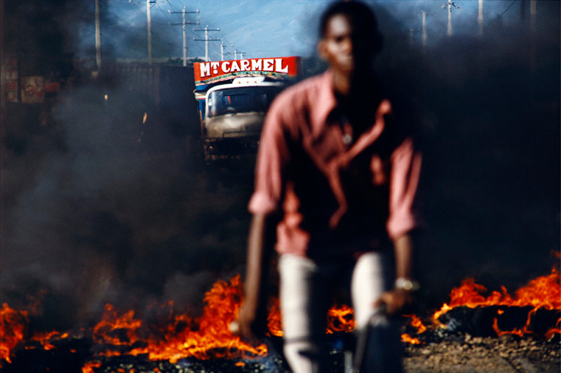 "<span class=""link fancybox-details-link""><a href=""/artists/85-alex-webb/works/17149-alex-webb-port-au-prince-haiti-1987/"">View Detail Page</a></span><div class=""artist""><strong>Alex Webb</strong></div> b. 1952 <div class=""title""><em>Port-au-Prince, Haiti</em>, 1987</div> <div class=""signed_and_dated"">Signed, titled, dated, and editioned, in ink, au mount verso<br /> Printed in 2011</div> <div class=""medium"">Chromogenic print mounted to archival board</div> <div class=""dimensions"">18 ½ x 28 inch (46.99 x 71.12 cm) image<br /> 24 ¾ x 34 inch (62.87 x 86.36 cm) paper/ board</div> <div class=""edition_details"">Edition of 20 (#3/20)</div><div class=""copyright_line"">© Alex Webb / Magnum Photos</div>"