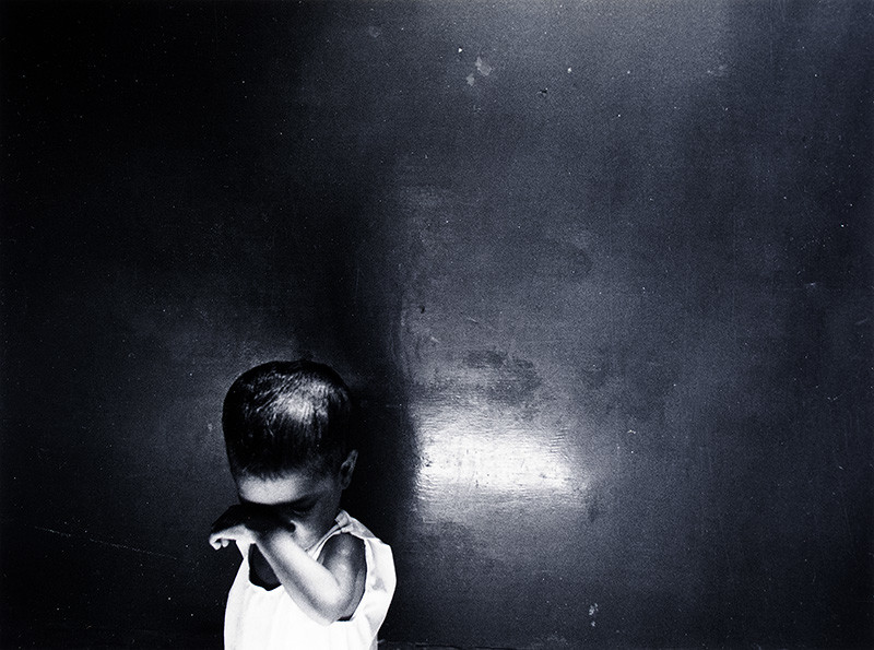 """<span class=""""link fancybox-details-link""""><a href=""""/artists/110-larry-towell/works/35031-larry-towell-untitled-portrait-of-a-boy-circa-1981/"""">View Detail Page</a></span><div class=""""artist""""><strong>Larry Towell</strong></div> b. 1953 <div class=""""title""""><em>Untitled [Portrait of a boy]</em>, circa 1981</div> <div class=""""signed_and_dated"""">Signed, in pencil, au verso<br /> Printed circa 1981</div> <div class=""""medium"""">Gelatin silver print</div> <div class=""""dimensions"""">7 ¾ x 10 ½ inch (19.69 x 26.67 cm) image<br /> 10 ¾ x 13 ¾ inch (27.31 x 34.93 cm) paper</div> <div class=""""edition_details""""></div><div class=""""copyright_line"""">© Larry Towell / Magnum Photos</div>"""