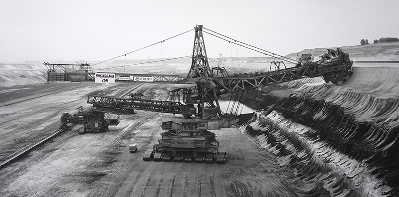 "<span class=""link fancybox-details-link""><a href=""/artists/128-claudia-fahrenkemper/works/32642-claudia-fahrenkemper-shovel-wheel-excavator-256-lignite-mine-garzweiler-germany-1991/"">View Detail Page</a></span><div class=""artist""><strong>Claudia Fährenkemper</strong></div> b. 1959 <div class=""title""><em>Shovel Wheel Excavator 256, Lignite Mine, Garzweiler, Germany</em>, 1991</div> <div class=""signed_and_dated"">From the series ""Mining Machinery""<br /> Signed, titled, dated, and editioned, in pencil, au verso<br /> Printed in 2008</div> <div class=""medium"">Gelatin silver print</div> <div class=""dimensions"">9 ¼ x 18 ½ inch (23.50 x 47.00 cm) image<br /> 10 ½ x 20 inch (26.67 x 50.80 cm) paper</div> <div class=""edition_details"">Edition of 8 + 3 APs (#3/8)</div>"