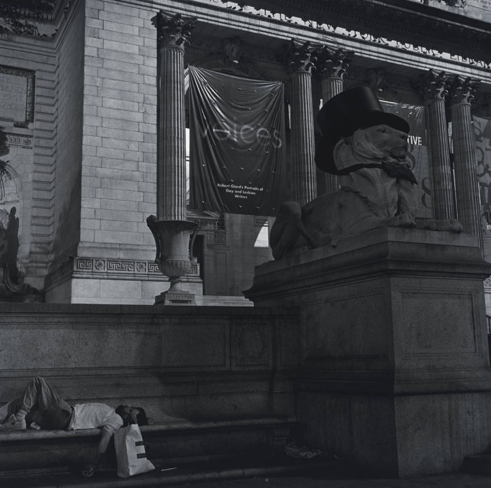 """<span class=""""link fancybox-details-link""""><a href=""""/artists/70-robert-giard/works/34808-robert-giard-particular-voices-banner-new-york-public-library-1998/"""">View Detail Page</a></span><div class=""""artist""""><strong>Robert Giard</strong></div> 1939-2002 <div class=""""title""""><em>'Particular Voices' banner, New York Public Library</em>, 1998</div> <div class=""""signed_and_dated"""">Annotated, in pencil, au verso<br /> Estate Accession #0012e [GS]<br /> Provenance: Direct from the Estate of Robert Giard, New York<br /> Printed in 1999</div> <div class=""""medium"""">Gelatin silver print</div> <div class=""""dimensions"""">14 ⅛ x 14 ⅛ inch (35.88 x 35.88 cm) image<br /> 19 ¾ x 15 ⅞ inch (50.17 x 40.32 cm) paper</div> <div class=""""edition_details""""></div>"""