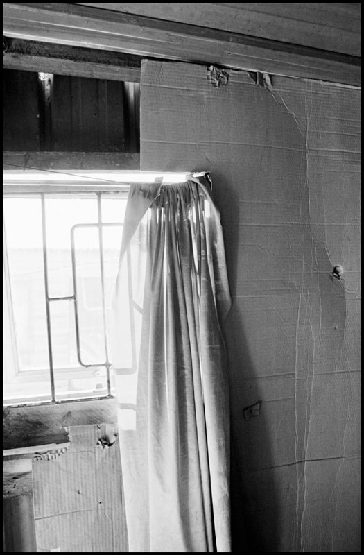 """<span class=""""link fancybox-details-link""""><a href=""""/artists/110-larry-towell/works/16088-larry-towell-interior-of-aids-patient-s-home-gugulethu-township-cape-2008/"""">View Detail Page</a></span><div class=""""artist""""><strong>Larry Towell</strong></div> b. 1953 <div class=""""title""""><em>Interior of AIDS Patient's home, Gugulethu Township, Cape Town, South Africa [14]</em>, 2008</div> <div class=""""signed_and_dated"""">Signed, titled, and dated, in pencil, au mount verso<br /> Printed in 2010</div> <div class=""""medium"""">Gelatin silver print mounted to archival board</div> <div class=""""dimensions"""">19 ¼ x 13 inch (48.9 x 33.02 cm)</div> <div class=""""edition_details"""">Edition of 25 (#1/25)</div><div class=""""copyright_line"""">© Larry Towell / Magnum Photos</div>"""