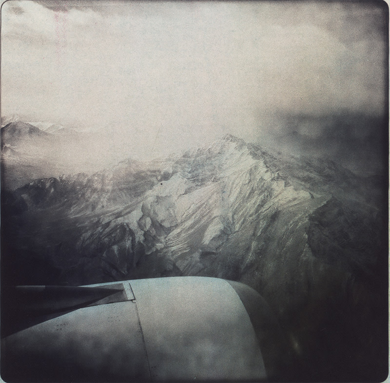 """<span class=""""link fancybox-details-link""""><a href=""""/artists/45-rita-leistner/works/33639-rita-leistner-view-of-himalaya-mountain-range-from-airplane-2011/"""">View Detail Page</a></span><div class=""""artist""""><strong>Rita Leistner</strong></div> b. 1964 <div class=""""title""""><em>View of Himalaya mountain range from airplane</em>, 2011</div> <div class=""""signed_and_dated"""">From the series """"Looking for Marshall McLuhan in Afghanistan""""<br /> Signed, titled, dated, and editioned, with printer's signature, in pencil, au verso <br /> Printed in 2018</div> <div class=""""medium"""">Unique tri-colour gum bichromate on palladium print </div> <div class=""""dimensions"""">8 ⅜ x 8 ½ inch (21.27 x 21.59 cm) image<br /> 11 x 14 inch (27.94 x 35.56 cm) paper</div> <div class=""""edition_details"""">Edition of 7 + 2 APs (#3/7)</div>"""