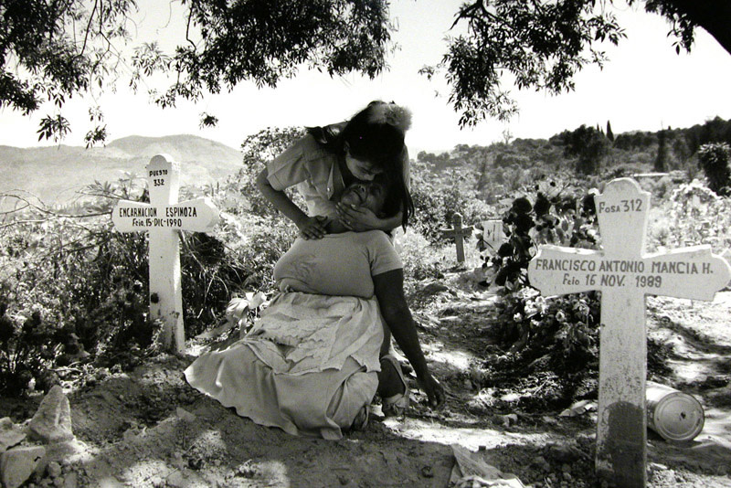 "<span class=""link fancybox-details-link""><a href=""/artists/110/series/el-salvador/6371-larry-towell-grieving-mother-in-cemetery-san-salvador-el-salvador-1991/"">View Detail Page</a></span><div class=""artist""><strong>Larry Towell</strong></div> b. 1953 <div class=""title""><em>Grieving Mother in Cemetery, San Salvador, El Salvador</em>, 1991</div> <div class=""signed_and_dated"">Artist's blindstamp au recto,<br /> Signed, titled, and dated, in pencil, with Magnum stamp in ink, au verso<br /> Printed in 1998</div> <div class=""medium"">Gelatin silver print</div> <div class=""dimensions"">11 x 14 inch (27.94 x 35.56 cm)</div><div class=""copyright_line"">© Larry Towell / Magnum Photos</div>"