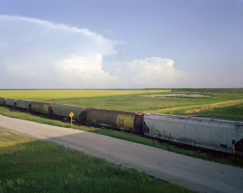 <span class=&#34;link fancybox-details-link&#34;><a href=&#34;/artists/104-scott-conarroe/works/31735-scott-conarroe-canola-train-manitoba-2008/&#34;>View Detail Page</a></span><div class=&#34;artist&#34;><strong>Scott Conarroe</strong></div> b. 1974 <div class=&#34;title&#34;><em>Canola Train, Manitoba</em>, 2008</div> <div class=&#34;signed_and_dated&#34;>Signed, titled, dated, and editioned, in ink, au verso</div> <div class=&#34;medium&#34;>Pigment print on archival paper mounted to archival board</div> <div class=&#34;dimensions&#34;>31 x 39 inch (78.74 x 99.06 cm) print<br /> 40 x 47 ½ inch (101.6 x 120.65 cm) board</div> <div class=&#34;edition_details&#34;>Edition of 10</div><div class=&#34;copyright_line&#34;>© Scott Conarroe</div>