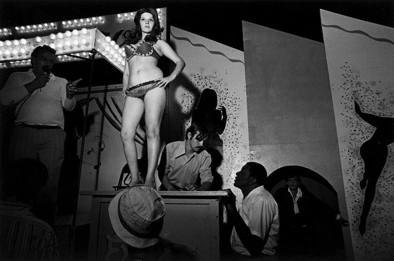 "<span class=""link fancybox-details-link""><a href=""/artists/48/series/carnival-strippers/11537-susan-meiselas-lena-on-the-bally-box-1973/"">View Detail Page</a></span><div class=""artist""><strong>Susan Meiselas</strong></div> b. 1948 <div class=""title""><em>Lena on the Bally Box</em>, 1973</div> <div class=""signed_and_dated"">Signed, titled, and dated, in pencil, au verso<br /> Artist's Ref NYC15658<br /> Printed in 2008</div> <div class=""medium"">Gelatin silver print</div> <div class=""dimensions"">12 x 18 ¼ inch (30.48 x 46.36 cm) image<br /> 16 x 20 inch (40.64 x  50.80 cm) paper</div> <div class=""edition_details""></div><div class=""copyright_line"">© Susan Meiselas / Magnum Photos</div>"