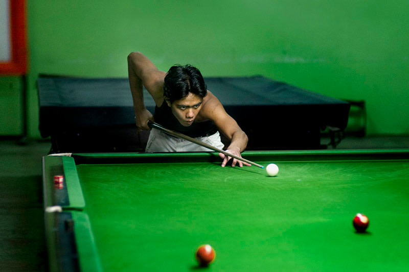 """<span class=""""link fancybox-details-link""""><a href=""""/artists/108/series/snooker%3A-thailand-and-burma/20220-john-lucas-untitled-1-yangon-2013/"""">View Detail Page</a></span><div class=""""artist""""><strong>John Lucas</strong></div> <div class=""""title""""><em>Untitled #1 Yangon</em>, 2013</div> <div class=""""signed_and_dated"""">Signed and dated, in pencil, au mount verso<br /> Printed in 2015</div> <div class=""""medium"""">Pigment print mounted to archival board</div> <div class=""""dimensions"""">13 ½ x 20 inch (34.29 x 50.80 cm) image<br /> 17 ½ x 24 inch (44.45 x 60.96 cm) board</div> <div class=""""edition_details"""">Edition of 15 (#One/15)</div><div class=""""copyright_line""""> </div>"""
