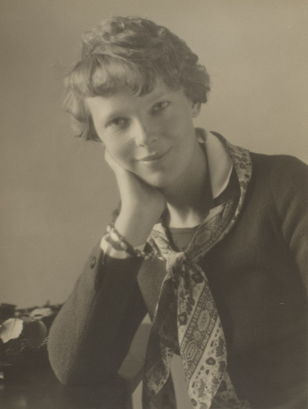 "<span class=""link fancybox-details-link""><a href=""/artists/130-violet-keene-perinchief/works/34223-violet-keene-perinchief-amelia-earhart-toronto-1932/"">View Detail Page</a></span><div class=""artist""><strong>Violet Keene Perinchief</strong></div> 1893-1987 <div class=""title""><em>Amelia Earhart, Toronto</em>, 1932</div> <div class=""signed_and_dated"">Signed, in pencil, au mount recto<br /> Titled, in pencil, au mount verso<br /> Estate # V36<br /> Printed circa 1932</div> <div class=""medium"">Silver bromide print mounted to period paper, mounted to additional two-ply period board</div> <div class=""dimensions"">12 ⅝ x 9 ½ inch (32.07 x 24.13 cm) print<br /> 14 ¾ x 10 ½ inch (37.47 x 26.67 cm) paper<br /> 20 x 15 ⅞ inch (50.80 x 40.32 cm) board</div> <div class=""edition_details""></div>"