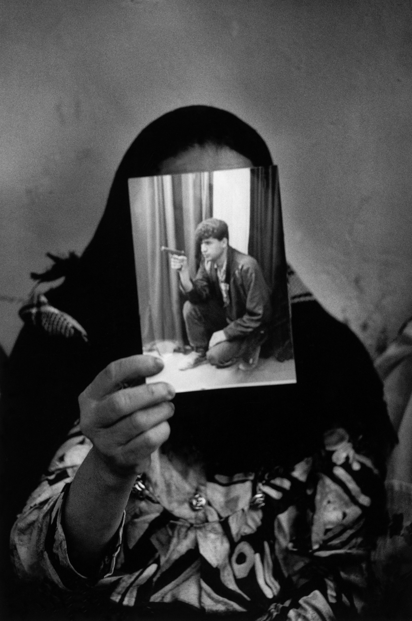 """<span class=""""link fancybox-details-link""""><a href=""""/artists/110-larry-towell/works/35053-larry-towell-shati-refugee-camp-gaza-1993/"""">View Detail Page</a></span><div class=""""artist""""><strong>Larry Towell</strong></div> b. 1953 <div class=""""title""""><em>Shati refugee camp, Gaza</em>, 1993</div> <div class=""""signed_and_dated"""">Signed, titled, and dated, in pencil, au verso<br /> Printed in 2002</div> <div class=""""medium"""">Gelatin silver print</div> <div class=""""dimensions"""">18 x 12 inch (45.72 x 30.48 cm) image<br /> 19 ¾ x 15 ¾ inch (50.17 x 40.01 cm) paper</div> <div class=""""edition_details""""></div><div class=""""copyright_line"""">© Larry Towell / Magnum Photos</div>"""
