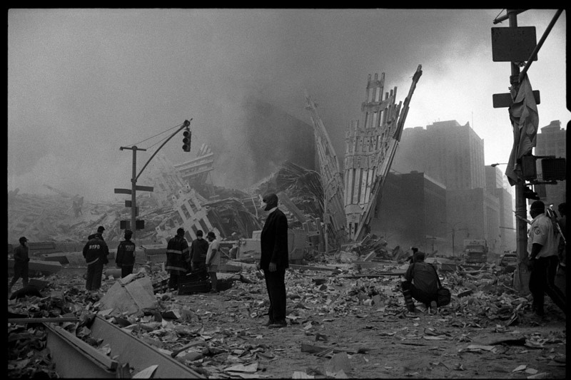 """<span class=""""link fancybox-details-link""""><a href=""""/artists/110-larry-towell/works/7102-larry-towell-world-trade-center-priest-standing-in-rubble-2001/"""">View Detail Page</a></span><div class=""""artist""""><strong>Larry Towell</strong></div> b. 1953 <div class=""""title""""><em>World Trade Center [Priest standing in rubble]</em>, 2001</div> <div class=""""signed_and_dated"""">Artist blindstamp au recto<br /> Signed, titled and dated, in pencil, au verso<br /> Printed in 2005</div> <div class=""""medium"""">Gelatin silver print</div> <div class=""""dimensions"""">20 x 30 inch (50.80 x 76.20 cm) image<br /> 24 x 36 inch (60.96 x 91.44 cm) paper</div> <div class=""""edition_details""""></div><div class=""""copyright_line"""">© Larry Towell / Magnum Photos</div>"""