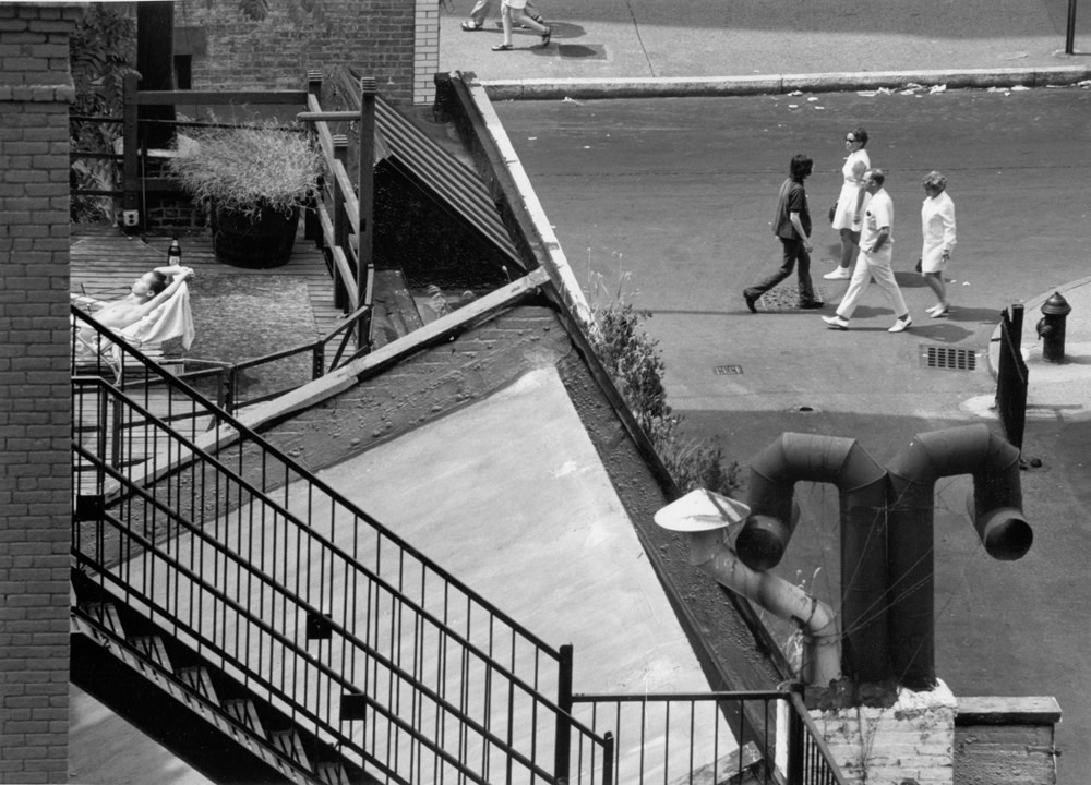 """<span class=""""link fancybox-details-link""""><a href=""""/artists/47-andre-kertesz/works/20315-andr-kert-sz-new-york-sunbather-on-roof-august-9-1969/"""">View Detail Page</a></span><div class=""""artist""""><strong>André Kertész</strong></div> 1894-1985 <div class=""""title""""><em>New York [sunbather on roof]</em>, August 9, 1969</div> <div class=""""signed_and_dated"""">Titled and annotated """"Ouverture Arts Kertesz"""",  in pencil, dated, in pencil and ink; Paris Scope stamp and artist stamp, in ink, au verso<br /> Estate #6-1603-001-2-1-32 E<br /> Printed in 1969<br /> Provenance: Direct from the Estate of André Kertész, New York</div> <div class=""""medium"""">Gelatin silver print</div> <div class=""""dimensions"""">7 x 9 ½ inch (17.78 x 24.13 cm) image<br /> 8 x 10 inch (20.32 x 25.40 cm) paper</div> <div class=""""edition_details""""></div><div class=""""copyright_line"""">© The Estate of André Kertész</div>"""
