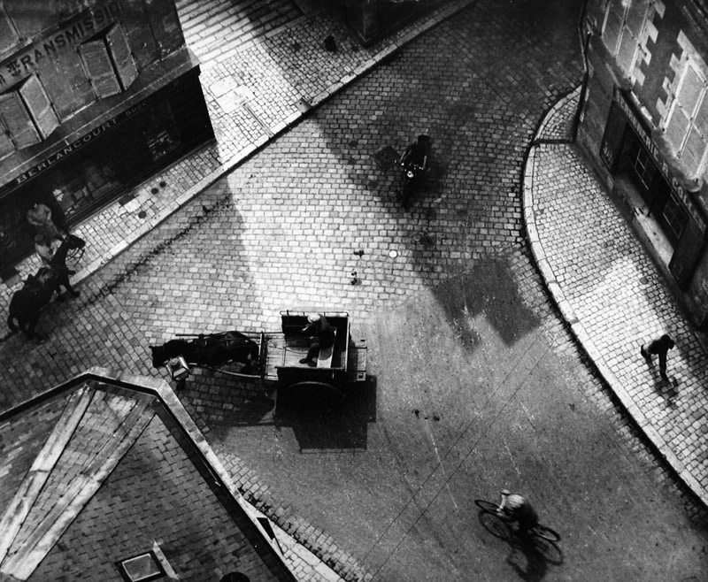 "<span class=""link fancybox-details-link""><a href=""/artists/47-andre-kertesz/works/6780-andre-kertesz-carrefour-blois-paris-1930/"">View Detail Page</a></span><div class=""artist""><strong>André Kertész</strong></div> 1894-1985 <div class=""title""><em>Carrefour Blois, Paris</em>, 1930</div> <div class=""signed_and_dated"">Dated, in pencil, with artist and estate stamps, in ink, au verso<br /> Estate #3-0141-09-2-1-02<br /> Printed circa 1964<br /> Provenance: Direct from the Estate of André Kertész, New York</div> <div class=""medium"">Gelatin silver print</div> <div class=""dimensions"">7 ¾ x 9 ½ inch (19.69 x 24.13 cm) image<br /> 8 x 10 inch (20.32 x 25.40 cm) paper</div> <div class=""edition_details""></div><div class=""copyright_line"">© The Estate of André Kertész</div>"
