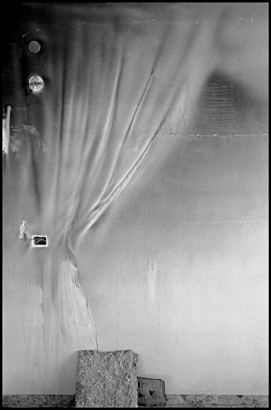 """<span class=""""link fancybox-details-link""""><a href=""""/artists/110-larry-towell/works/16095-larry-towell-jenin-refugee-camp-west-bank-7-may-2002/"""">View Detail Page</a></span><div class=""""artist""""><strong>Larry Towell</strong></div> b. 1953 <div class=""""title""""><em>Jenin Refugee Camp, West Bank [7]</em>, May 2002</div> <div class=""""signed_and_dated"""">Signed, titled, and dated, in pencil, au verso<br /> Printed in 2010</div> <div class=""""medium"""">Gelatin silver print</div> <div class=""""dimensions"""">15 x 22 ¾ inch (38.1 x 57.79 cm) image<br /> 20 x 24 inch (50.80 x 60.96 cm) paper</div> <div class=""""edition_details"""">Edition of 25 (#1/25)</div><div class=""""copyright_line"""">© Larry Towell / Magnum Photos</div>"""