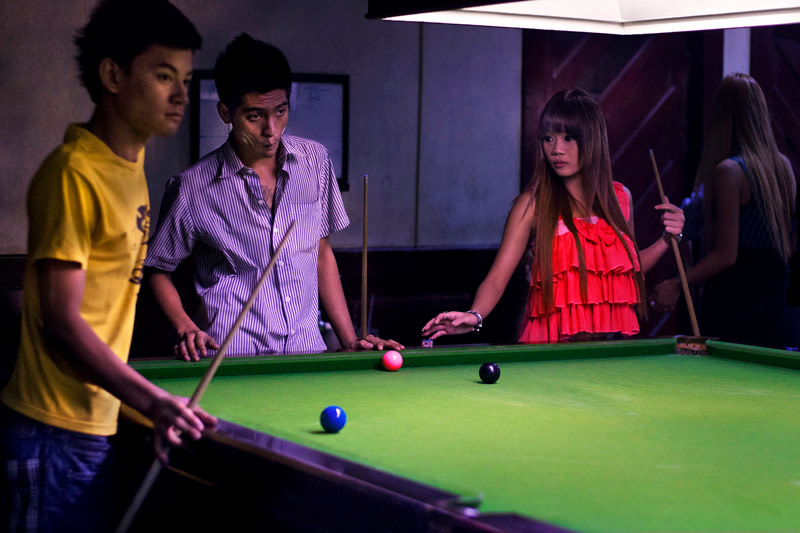 """<span class=""""link fancybox-details-link""""><a href=""""/artists/108/series/snooker%3A-thailand-and-burma/20537-john-lucas-untitled-1-bangkok-2012/"""">View Detail Page</a></span><div class=""""artist""""><strong>John Lucas</strong></div> <div class=""""title""""><em>Untitled #1 Bangkok</em>, 2012</div> <div class=""""signed_and_dated"""">Signed and dated, in pencil, au mount verso<br /> Printed in 2015</div> <div class=""""medium"""">Pigment print mounted to archival board</div> <div class=""""dimensions"""">13 ½ x 20 inch (34.29 x 50.8 cm) print<br /> 17 ½ x 24 inch (44.45 x 60.96 cm) board</div> <div class=""""edition_details"""">Edition of 15 (#One/15)</div><div class=""""copyright_line""""> </div>"""