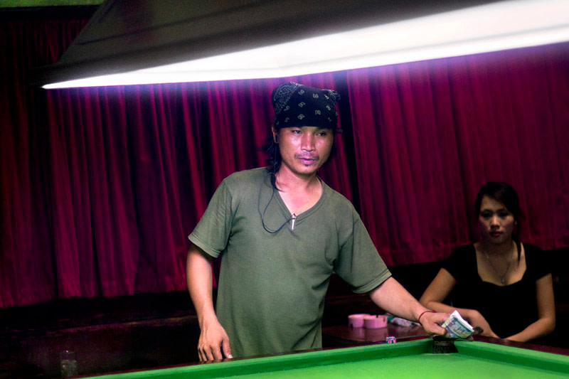 """<span class=""""link fancybox-details-link""""><a href=""""/artists/108/series/snooker%3A-thailand-and-burma/20538-john-lucas-untitled-11-bangkok-2012/"""">View Detail Page</a></span><div class=""""artist""""><strong>John Lucas</strong></div> <div class=""""title""""><em>Untitled #11 Bangkok</em>, 2012</div> <div class=""""signed_and_dated"""">From the series """"Snooker: Thailand & Burma""""<br /> Signed and dated, in pencil, au mount verso<br /> Printed in 2015</div> <div class=""""medium"""">Pigment print mounted to archival board</div> <div class=""""dimensions"""">13 ½ x 20 inch (34.29 x 50.8 cm) print<br /> 17 ½ x 24 inch (44.45 x 60.96 cm) board</div> <div class=""""edition_details"""">Edition of 15 (#One/15)</div><div class=""""copyright_line""""> </div>"""