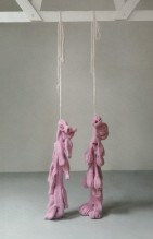Mr and Mrs Pope knitted, shrunk and hung, 2012