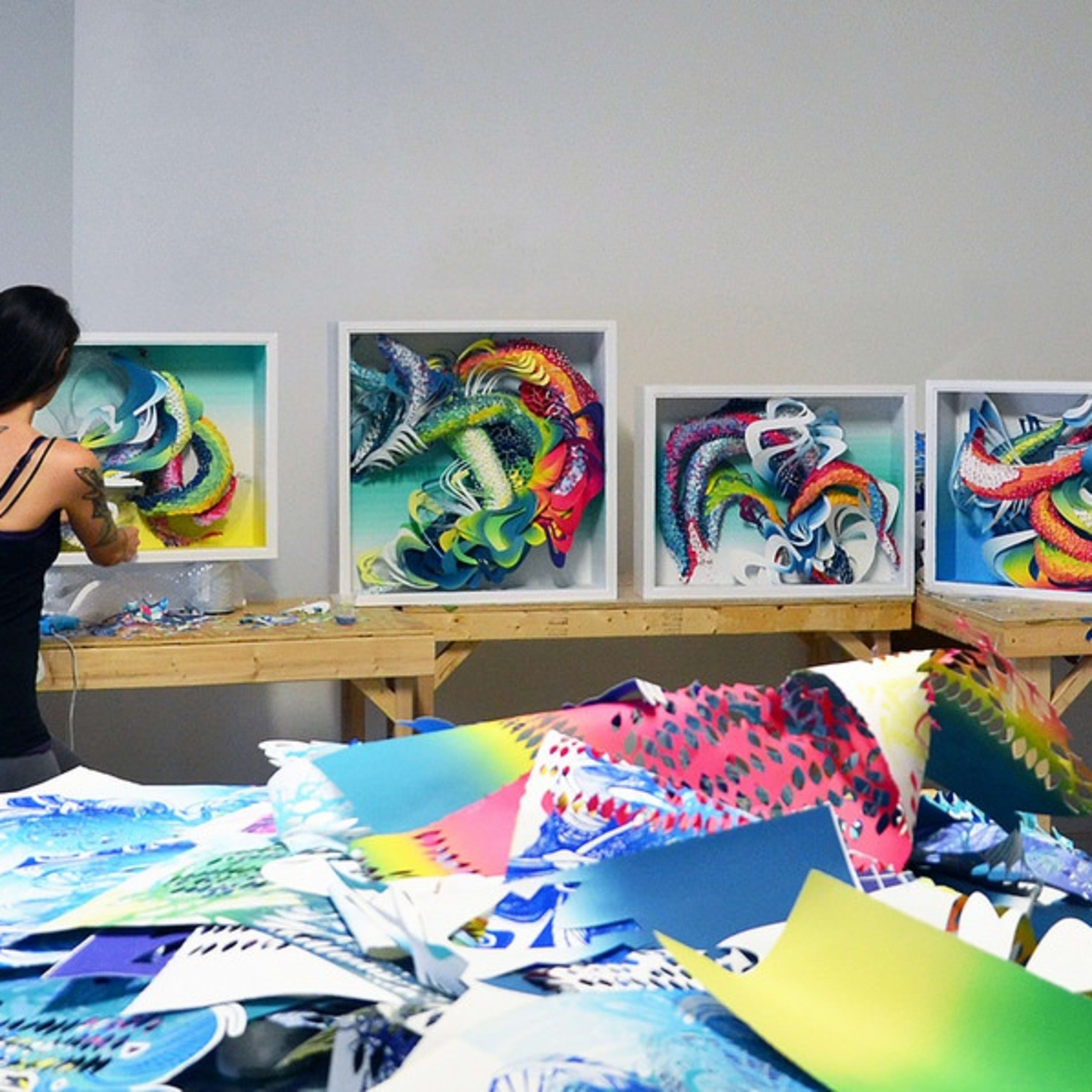 Portrait of artist Crystal Wagner at work in her studio