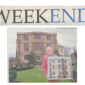 Michael Claydon with a painting  of Newark Park by Rob Collins of Wotton-under-Edge
