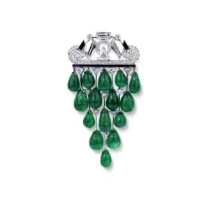 An Art Déco emerald, onyx and diamond brooch