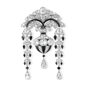 A Belle Epoque onyx and diamond devant-de-corsage brooch
