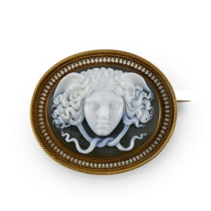 An agate cameo, gold and enamel brooch