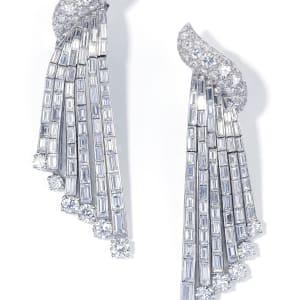 A pair of articulated diamond ear pendants