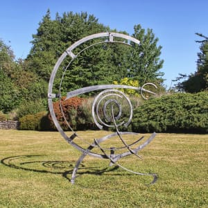 abstract kinetic sculpture in steel for the garden