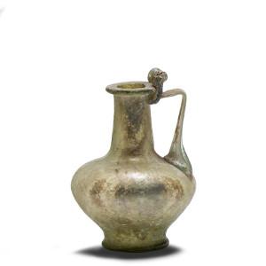 Roman clear blue-green jug with folded ribbon handle, Eastern Mediterranean, 1st century AD