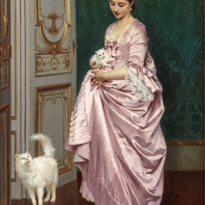 ELEGANT YOUNG WOMAN WITH TWO WHITE CATS