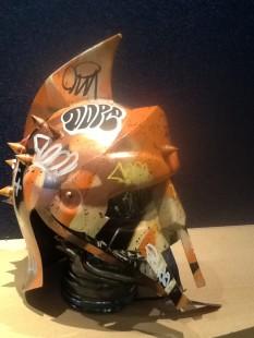 ZombieDan Vandal Helmet - Orange/Red, 2018 Gladiator Helmet with stencil work & graffiti displayed on a clear glass skull
