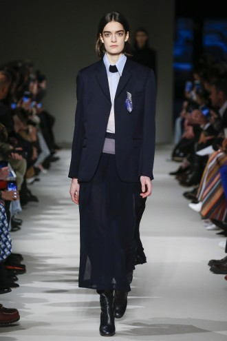 Emily Young's pendant Little Lapis Goddess II, 2016 featured in Victoria Beckham autumn winter 17 Ready–to-Wear collection in New York City.